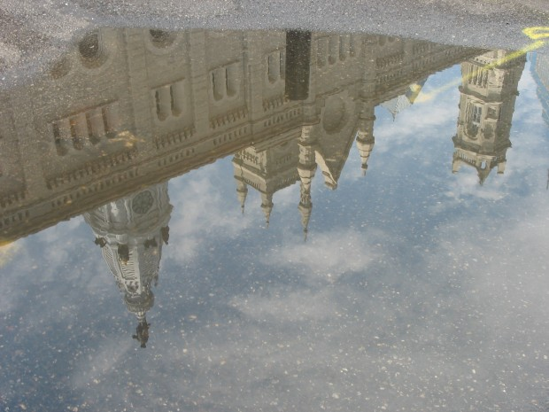 This is a picture of a reflection of Philadelphia's City Hall, which features a statue of William Penn at the top of the building. Photo by Sindora Stallworth.